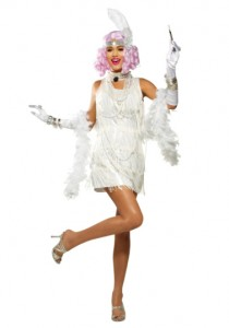 Snazzy Flapper, a white dress with fringe, comes with headband, pearls, fishnets and a cigarette holder
