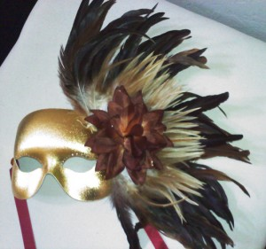 Custom-make gold mask with natural coque feathers and a brown rose