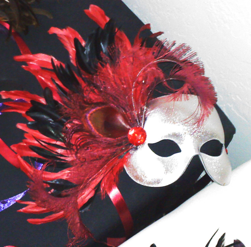 Silver and red custom mask with red and black coque and peacock feathers